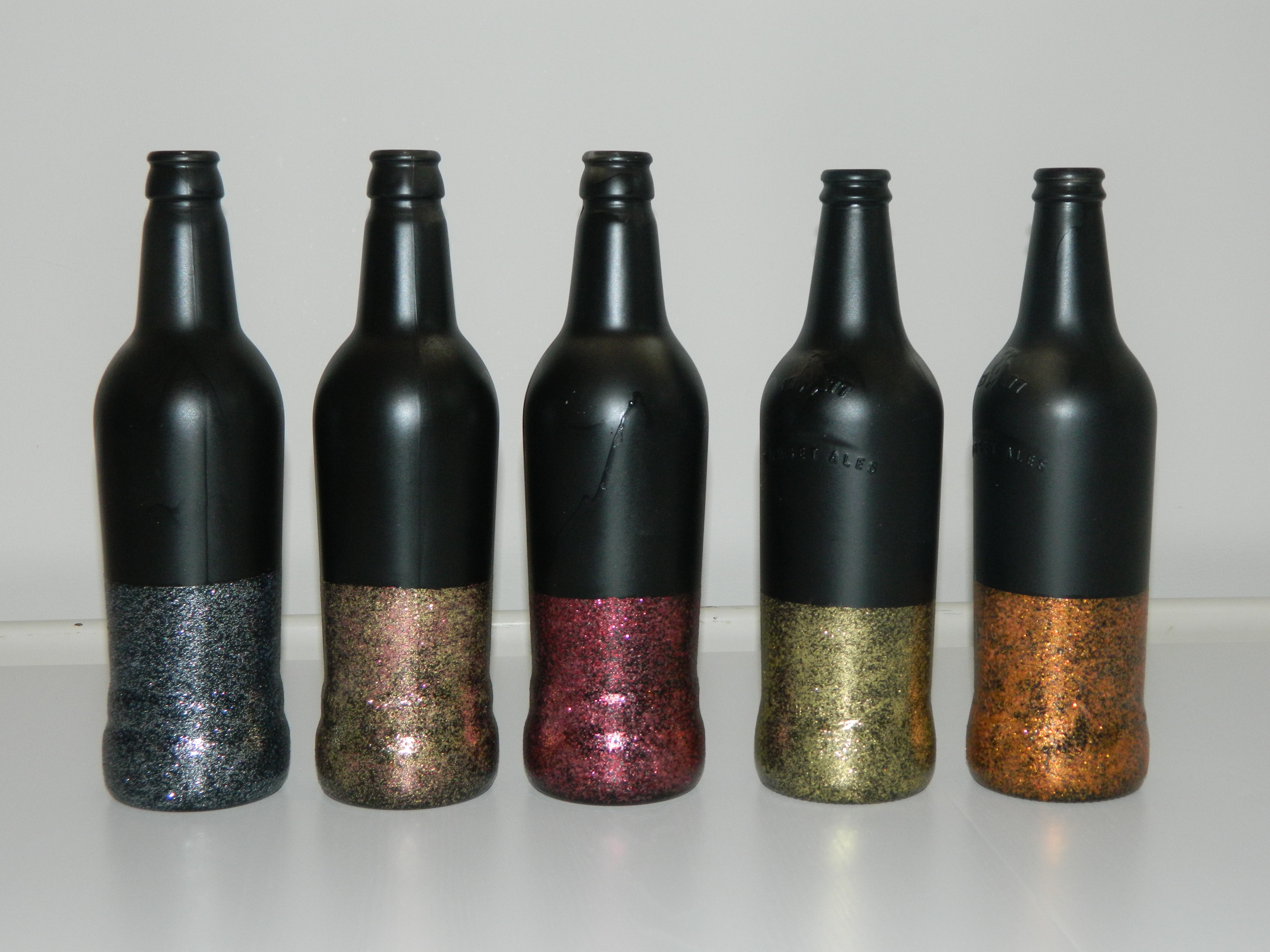 White glitter spray paint - And I Think My Favourite Pieces Of The Day The Glittery Black Bottles Whether These Will Hold The Table Numbers Or A Big Old Hydrangea Head I M Not Quite