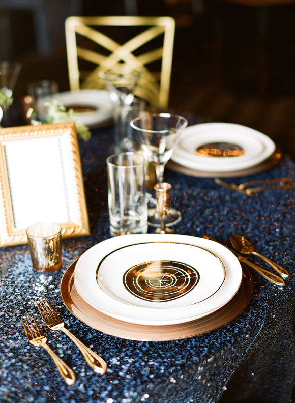 Gold place settings on navy sequinned linen, people! Glorious, magical image via Sceme Events