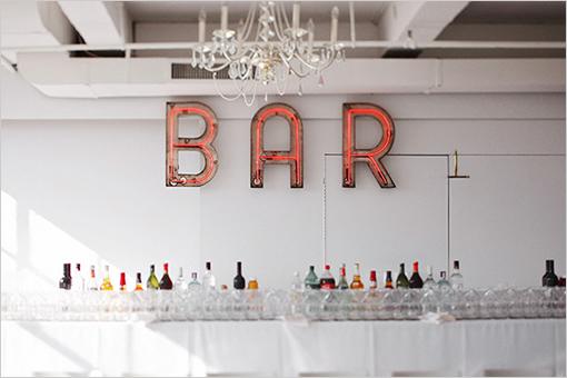 Love me a neon BAR sign. Image via Alexan Events