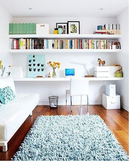 Source // Wall to wall shelving leaves room for a guest bed.